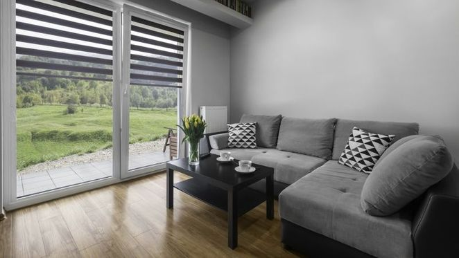 Modern blinds installed in a living room